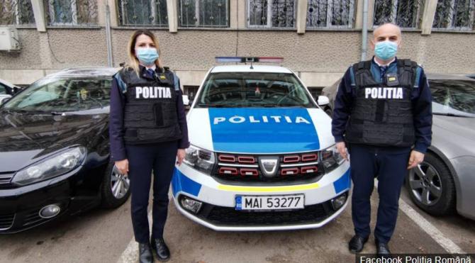 politisti_au_salvat_o_femeie_din_incediu