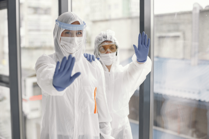 Coronavirus pandemic covid-2019. Protective suit, googles, gloves, mask.